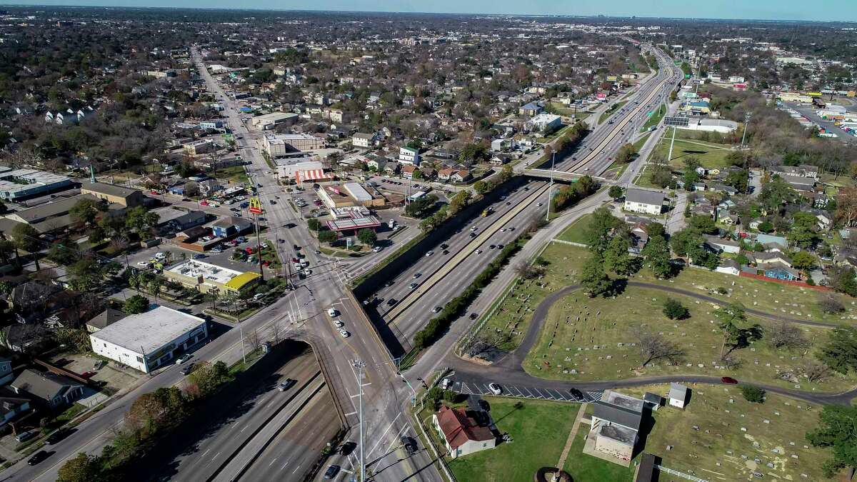 Interstate 45 runs past the Hollywood Cemetery at North Main Street in Houston, seen Jan. 7, 2020. A planned widening of I-45 will drastically change the area by removing homes and businesses close to the freeway and adding lanes.