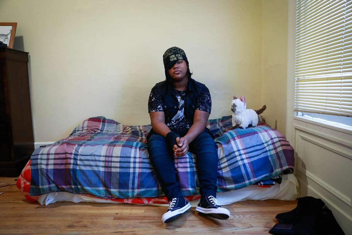 A trans woman named Kat sits for a portrait in her room in one of the first shelter-transitional housing programs in the United States for transgender youths in San Francisco, California, on Tuesday, April 16, 2019.