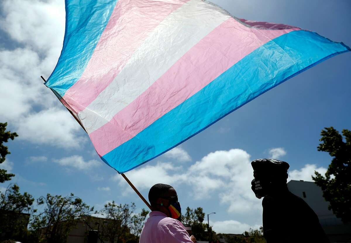 SF Pride Board President Carolyn Wysinger holds a transgender flag during Marsha P. Johnson Solidarity Rally at African American Art & Culture Complex on Fulton Street in San Francisco, Calif., on Sunday, June 28, 2020. The event aims to hold space for the voices of Black Trans community and also making space to listen to the Black Trans family.
