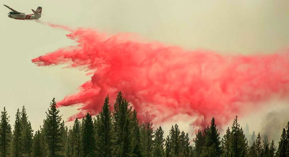 A CalFire aircraft drops fire retardant over the Hog fire, about 5 miles from Susanville, California, on July 21, 2020. (Photo by JOSH EDELSON / AFP) (Photo by JOSH EDELSON/AFP via Getty Images) Photo: JOSH EDELSON / AFP Via Getty Images / AFP or licensors