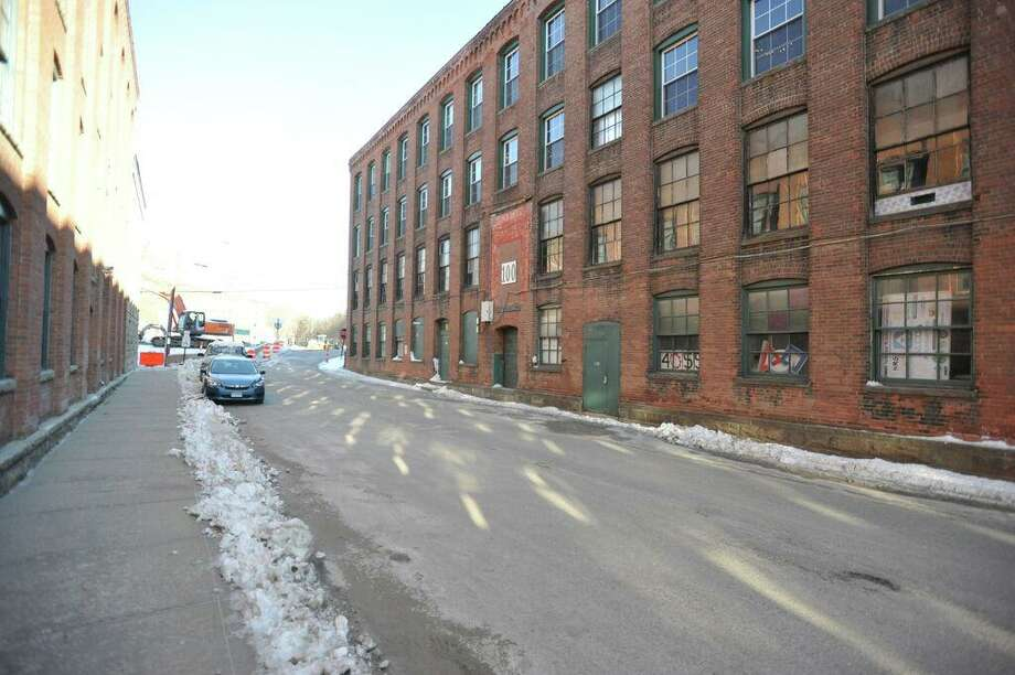 A view of Whiting Street on a winter day in 2018. The factory buildings on either side of the street were once used by the Winsted Hosiery Mill and other manufacturing companies. Photo: Ben Lambert / Hearst Connecticut Media /