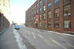 A view of Whiting Street on a winter day in 2018. The factory buildings on either side of the street were once used by the Winsted Hosiery Mill and other manufacturing companies.