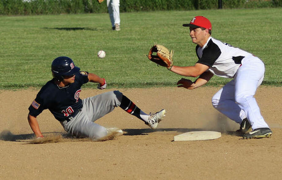 Alton's Owen Macias (left) gets back to second base safely by beating the pickoff throw from the catcher to Elsberry's second baseman in a June 11 game in Elsberry, Missouri. Photo: Greg Shashack | The Telegraph