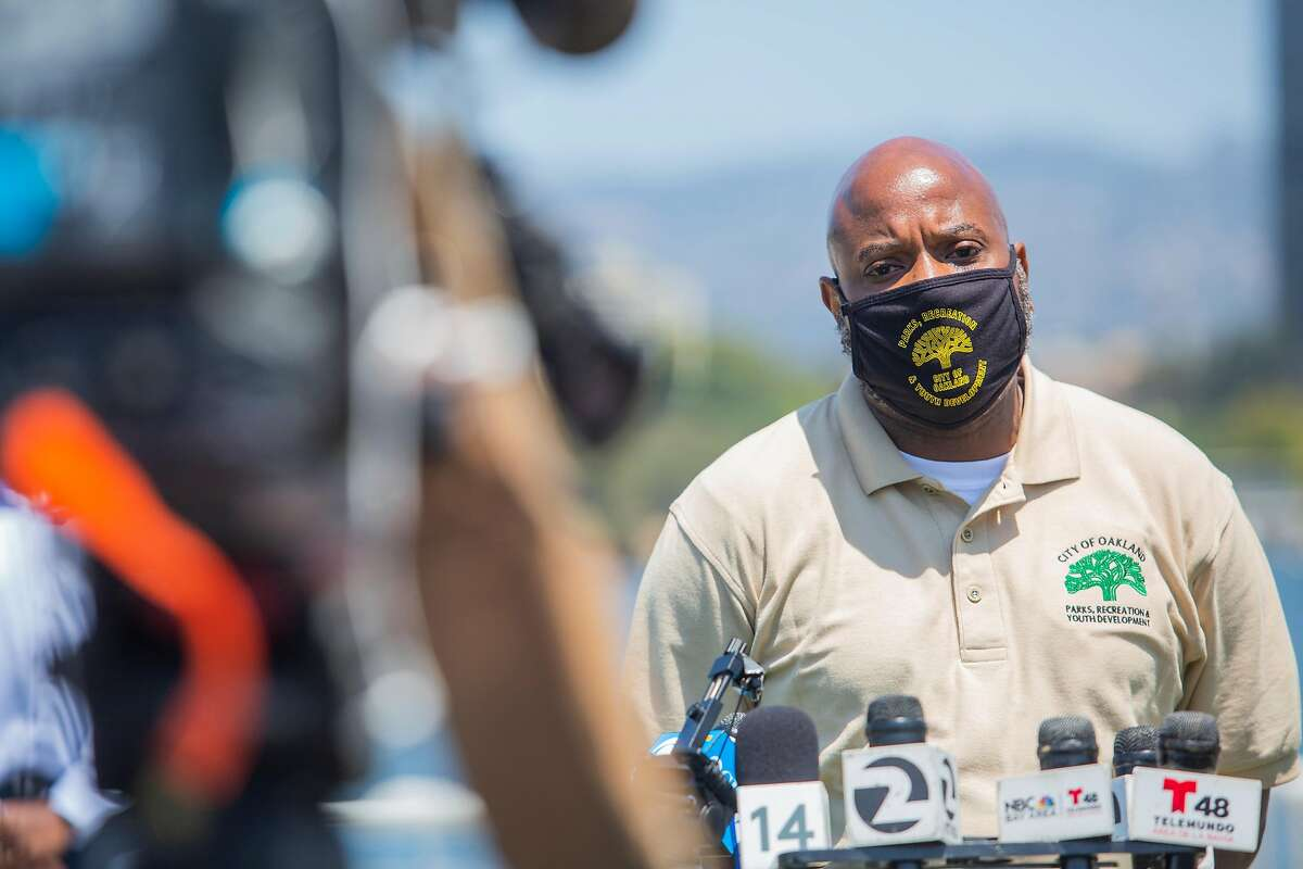 Nicholas Williams, Director of Oakland Parks, Recreation, and Youth Development, closes a press conference held at Lake Merritt in Oakland, CA on July 24, 2020. The press conference was held after new data showed a surge of new COVID-19 cases in the area.