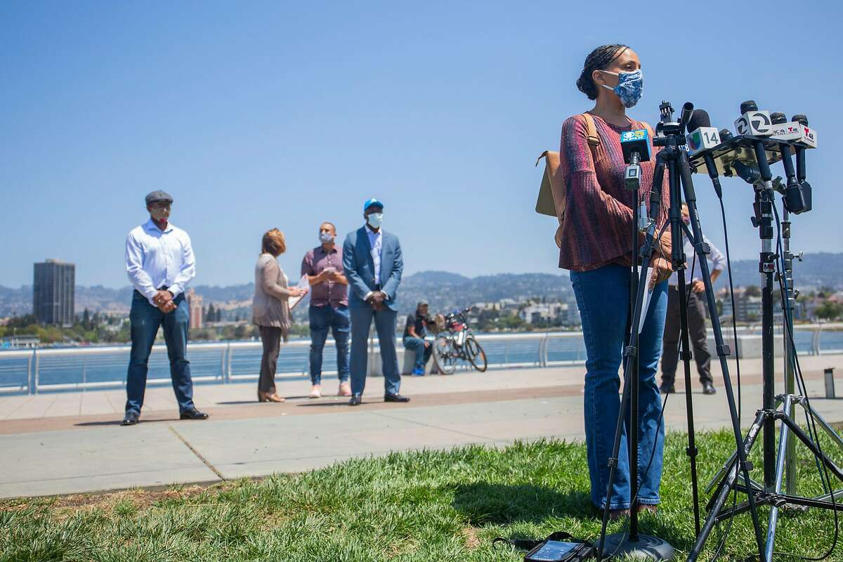 Dr. Noha Aboelata, CEO of Roots Community Health Center, speaks about her experience tracking local COVID-19 case data at a press conference on the shore of Lake Merritt in Oakland, CA on July 24, 2020.