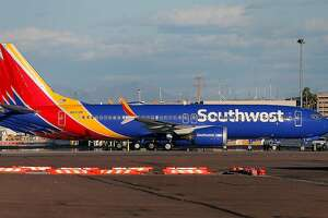 A group of Southwest Airlines Boeing 737 MAX 8 aircraft sit on the tarmac at Phoenix Sky Harbor International Airport on March 13, 2019 in Phoenix, Arizona. The United States has followed countries around the world and has grounded all Boeing 737 Max 8 aircraft following the crash of an Ethiopia Airlines 737 Max 8.  (Photo by Ralph Freso/Getty Images/TNS)