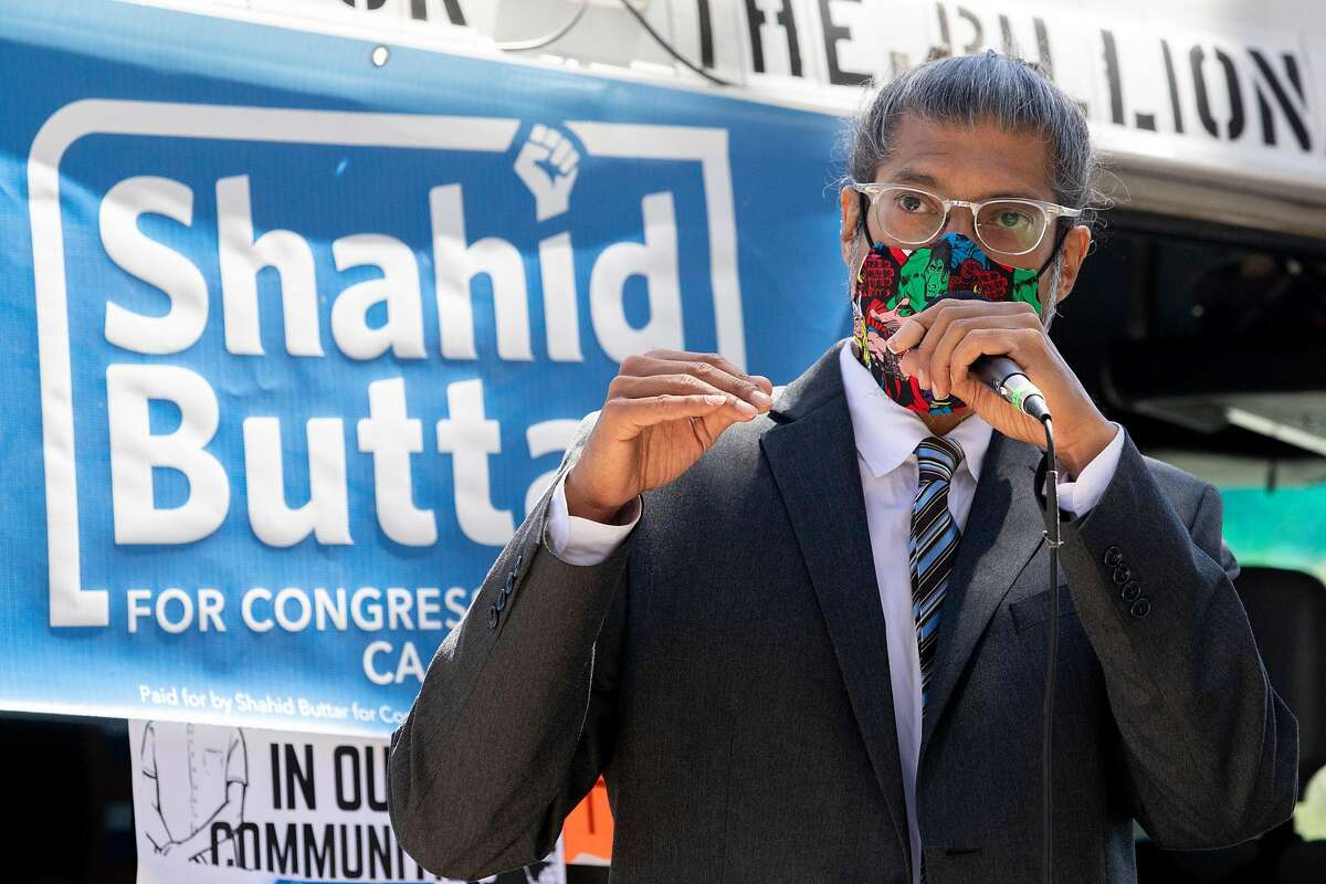 CA-12 Congressional candidate and Nancy Pelosi challenger Shahid Buttar addresses the crowd during a demonstration calling for Medicare for All and stimulus packages amid the COVID-19 pandemic held in front of San Francisco's Ferry Building in San Francisco, Calif. Saturday, July 11, 2020. The demonstration, led by the progressive Movement for a People's Party, is part of a nationwide set of demonstrations Saturday in front of Democratic lawmakers homes and offices, urging them to push for more Congressional stimulus packages.