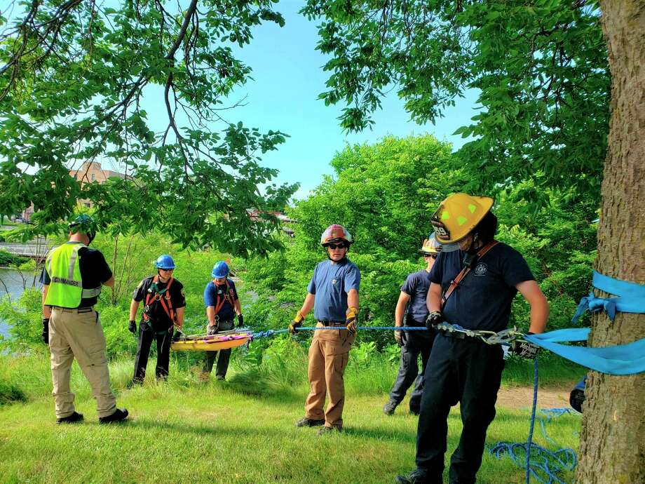 The city applied for hazard pay for police and fire department employees. Hazard pay stems from grants that aim to help first responders during the pandemic. In June, the Manistee Fire Department conducting a low angle rope rescue training exercise. (File photo)