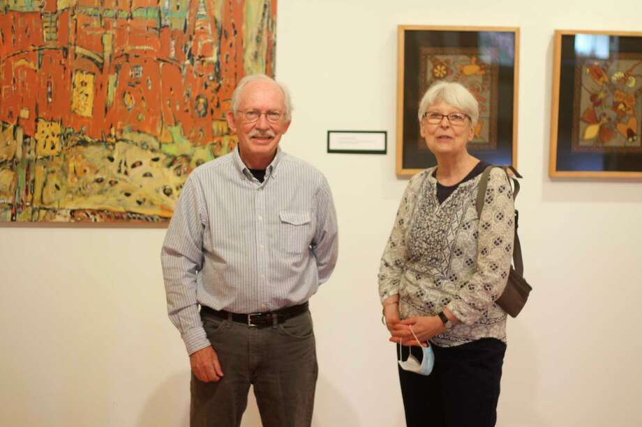 "Phil and Susan Joseph displayed their paintings at Hardy Hall at the Ramsdell Regional Center for the Arts on Friday in an exhibit called ""Joseph Works."" The exhibit will run on Fridays from noon to 3 p.m. throught Sept. 25. (Kyle Kotecki/News Advocate)"