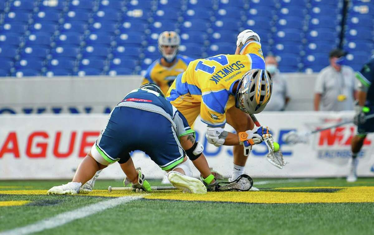 Justin Schwenk won 16 of 25 faceoffs as the Connecticut Hammerheads clinched a playoff berth with a third straight win on Friday.