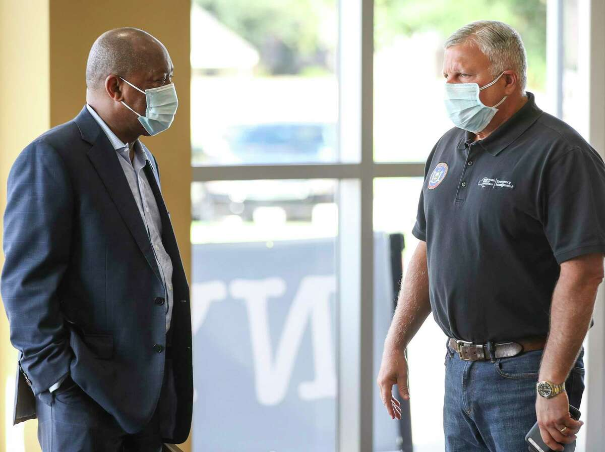 Houston Mayor Sylvester Turner, left, talks with an emergency management official from New York as they tour a COVID-19 testing site Friday, July 24, 2020, at Fallbrook Church in Houston.