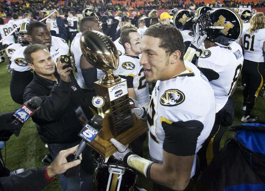 Michael Egnew of Missouri holds the rivalry trophy after beating Kansas on Saturday, November 26, 2011, in Kansas City, Missouri. (Shane Keyser/Kansas City Star/MCT) Photo: Shane Keyser/MCT