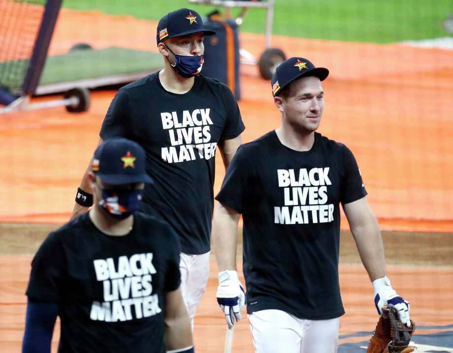 Houston Astros shortstop Carlos Correa, Alex Bregman and Aledmys Diaz walk back to the dugout wearing Black Lives Matters t-shirts before the start of the Houston Astros Opening Day at Minute Maid Park, Friday, July 24, 2020, in Houston. Photo: Karen Warren, Staff Photographer / © 2020 Houston Chronicle
