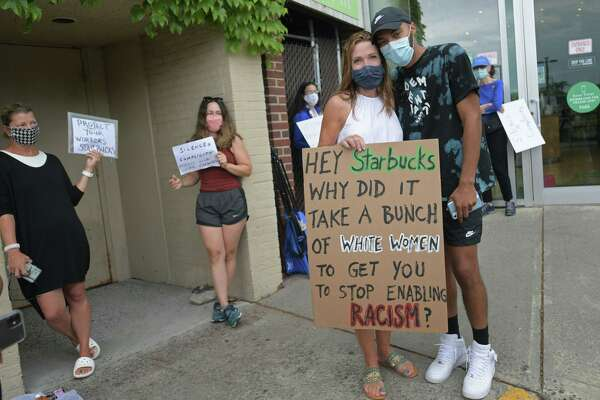 Protesters including Darcy Hicks gather to support an employee at the Starbucks in Parker Harding Plaza, Dayshawn Rodriguez, right, Friday July 25, 2020, who alleged harassment by a customer at the cafe in Westport, Conn.