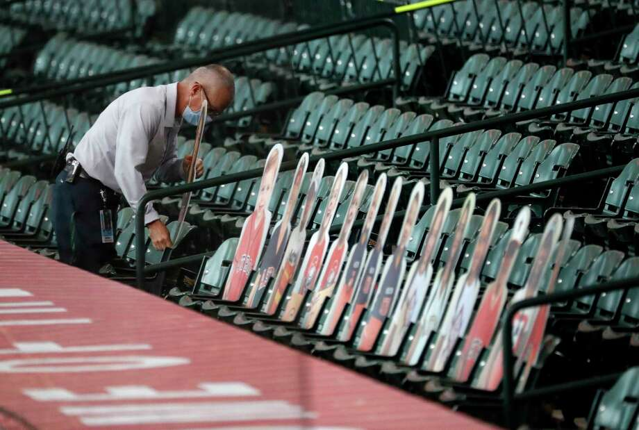 PHOTOS: The Astros family member's cardboard cutouts behind the dugout