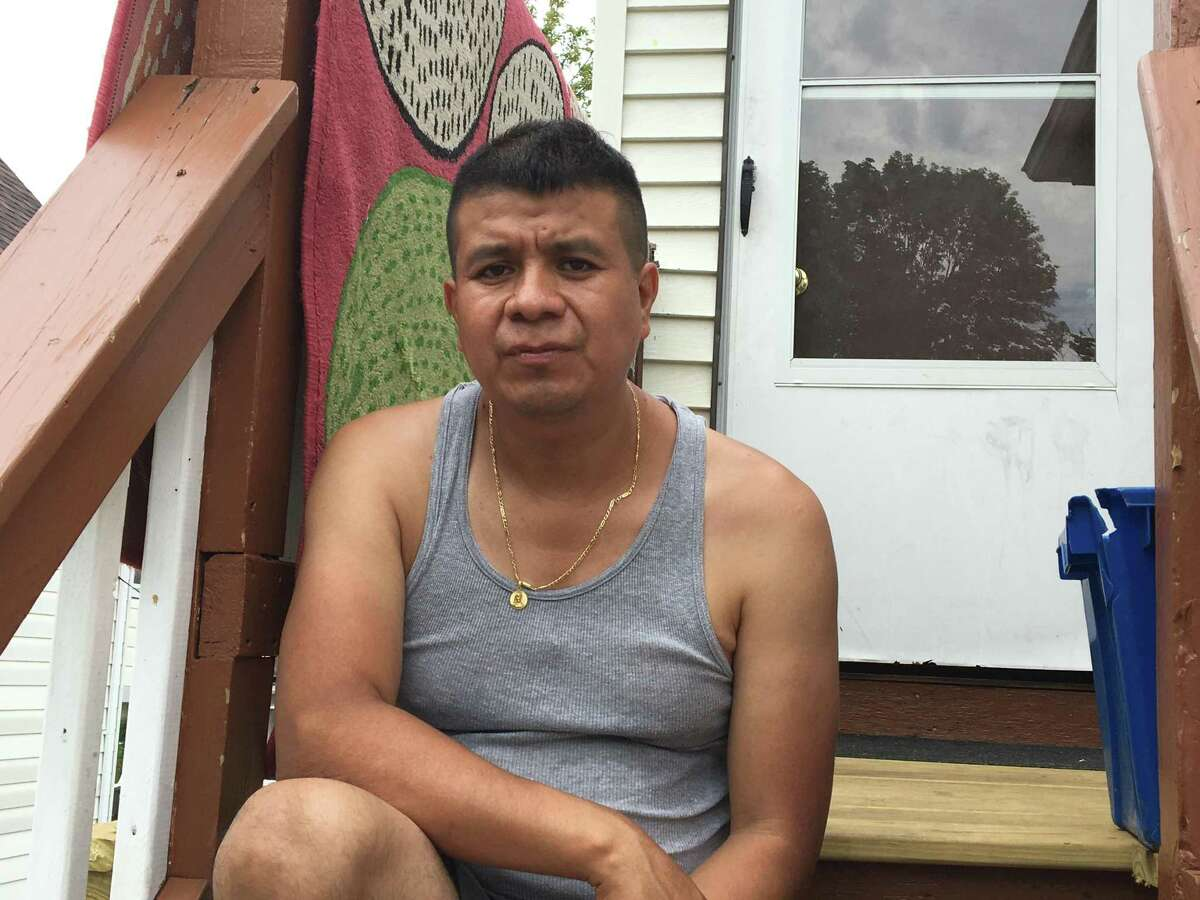 Albino Aleman Sedeño, father of the late Lizzbeth Aleman-Popoca, on the back steps of his home in New Haven's Fair Haven Heights section, July 23, 2020.