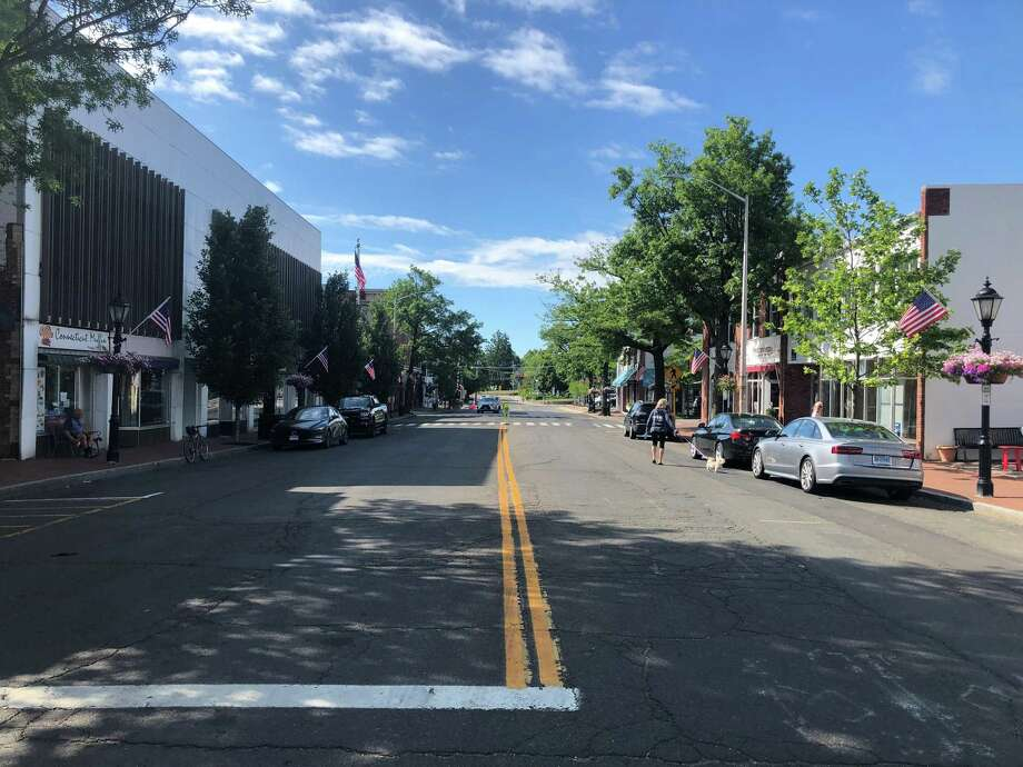 Part of Main Street in New Canaan is seen on a recent sunny Sunday this summer. The members of the town's Health and Human Services Commission thank the town, including the employees in its Department of Health and Human Services Department, residents, other people in the community, and non-profit organizations, and volunteers in the town for all of the support they have received, and continue to receive from them during the coronavirus pandemic, in this letter. Photo: Justin Stock / Hearst Connecticut Media