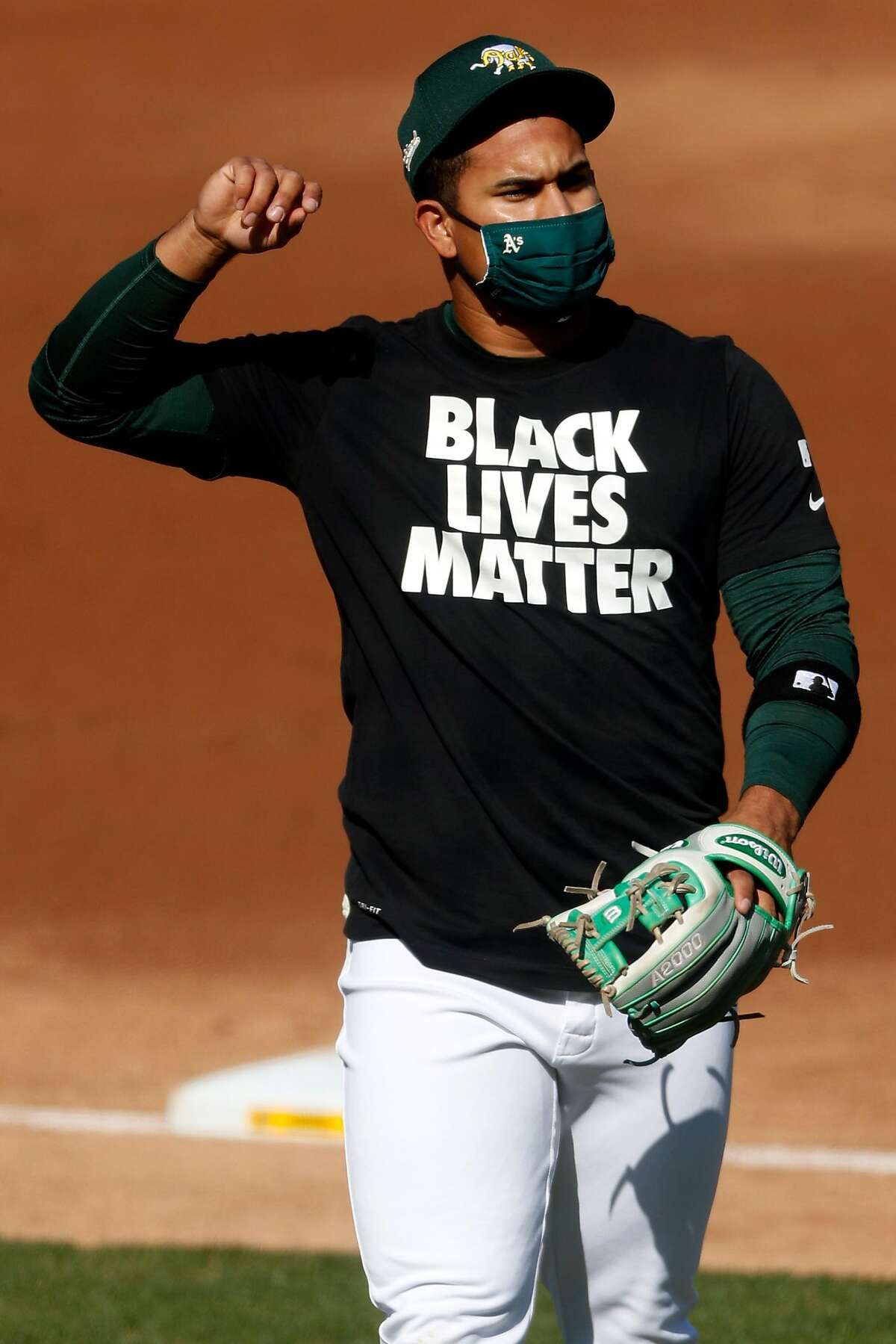 Oakland Athletics' Franklin Barreto wears a Black Lives Matter t-shirt before playing Los Angeles Angels in season opener at Oakland Coliseum in Oakland, Calif., on Friday, July 24, 2020.
