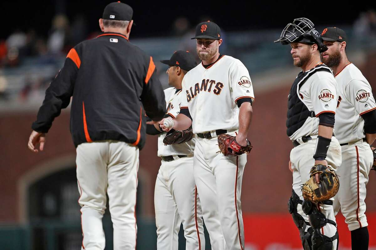 San Francisco Giants' manager Bruce Bochy removes Sam Coonrod in 6th inning against Arizona Diamondbacks in MLB game at Oracle Park in San Francisco, Calif., on Tuesday, August 27, 2019.