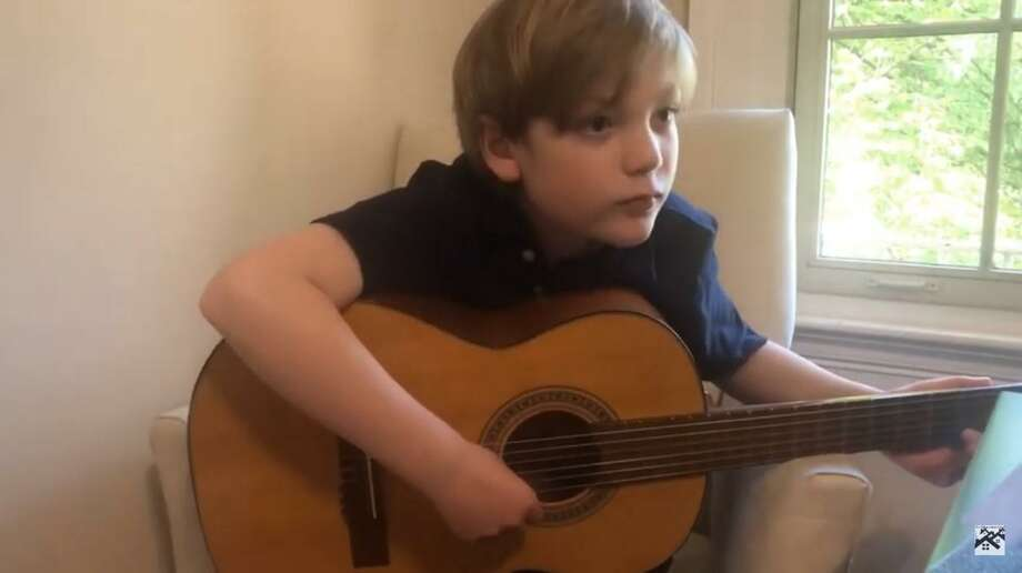 """Village Music School guitar student Brody M. plays """"Ode to Joy"""" in a video filmed for the center in Cornwall. Photo: Village Music Center / Contributed Photo /"""