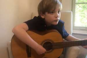 "Village Music School guitar student Brody M. plays ""Ode to Joy"" in a video filmed for the center in Cornwall."