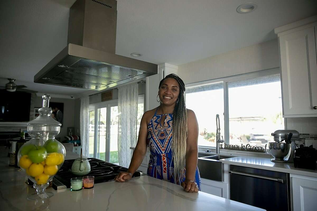 Sharie Wilson in the kitchen of her remodeled Elk Grove home on June 22, 2020. Wilson says that when the bought the home it was the 'worst on the block' but was able to turn it into a space that she's proud of.