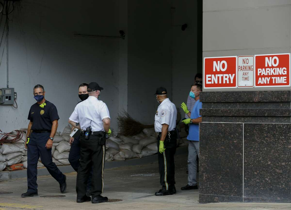 Houston Fire Department firefighters exit the scene at the Consulate General of China building Friday, July 24, 2020, in Houston. On Tuesday, the U.S. ordered the Houston consulate closed within 72 hours, alleging that Chinese agents had tried to steal data from facilities in Texas, including the Texas A&M medical system and The University of Texas MD Anderson Cancer Center in Houston.