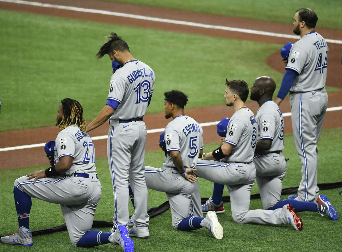 PHOTOS: More shots of Cavan Biggio during his rookie season last year ST PETERSBURG, FLORIDA - JULY 24: Vladimir Guerrero Jr. #27 of the Toronto Blue Jays takes a knee with other teammates as Lourdes Gurriel Jr. #13 and Rowdy Tellez #44 stand during the National Anthem prior to the game against the Tampa Bay Rays on Opening Day at Tropicana Field on July 24, 2020 in St Petersburg, Florida. The 2020 season had been postponed since March due to the COVID-19 pandemic.