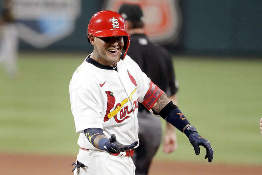 The Cardinals' Yadier Molina smiles after hitting an RBI single in the sixth inning of Friday night's game against the Pittsburgh Pirates at Busch Stadium. Photo: Jeff Roberson | AP Photo