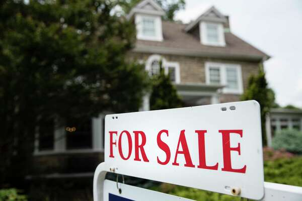 """In this Friday, June 8, 2018, photo, a """"For Sale"""" sign stands in front of a house, in Jenkintown, Pa. (AP Photo/Matt Rourke)"""