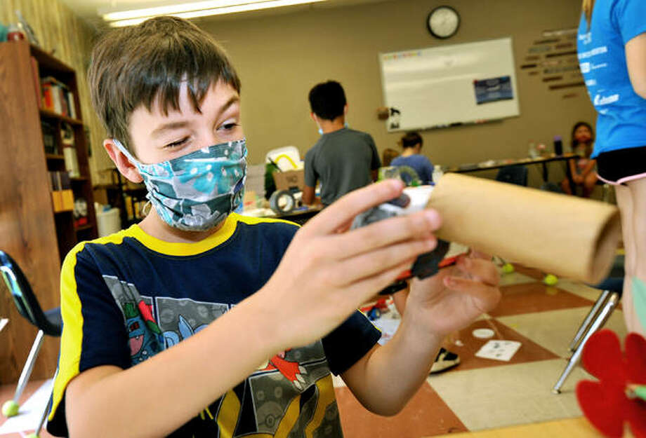 Nathan Epperheimer, 8, of Collinsville works on the camera part of his prototype invention during Camp Invention at St. John Neumann Catholic School in Maryville. Photo: Thomas Turney | For The Intelligencer