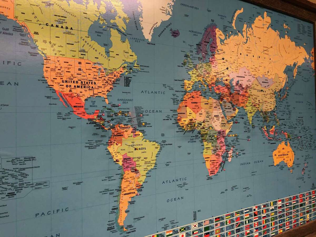 A world map on the wall of one of the rooms at the Medical Bridges building contains pushpins showing everywhere in the world where it has sent a shipment of medical supplies