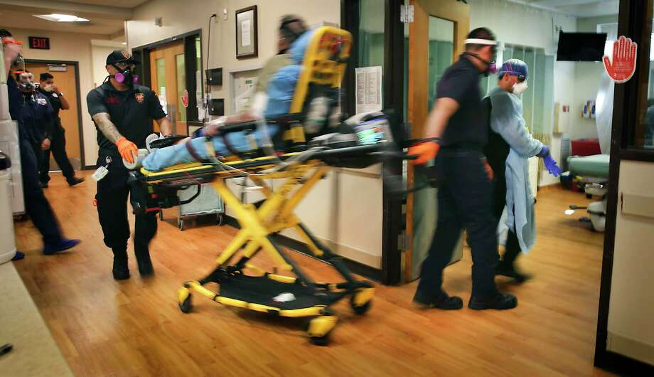 A COVID-19 patient, already receiving oxygen, is rushed into the emergency room for treatment at Christus Santa Rosa on July 20, 2020. More than 1,000 people are hospitalized in San Antonio for COVID-19. / ©2020 San Antonio Express-News