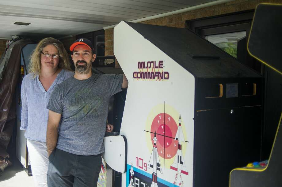 Belle Fawcett and Scott Nankervis pose for a portrait Tuesday, July 21, 2020 alongside damaged arcade games which were intended for the Brinstar Beercade and Grill, before COVID-19 and the flooding in May altered their business plans. (Katy Kildee/kkildee@mdn.net) Photo: (Katy Kildee/kkildee@mdn.net)