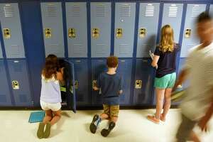 Students walk through the halls on the first day of school at Eastern Middle School in Greenwich, Conn. Wednesday, Sept. 2, 2015.
