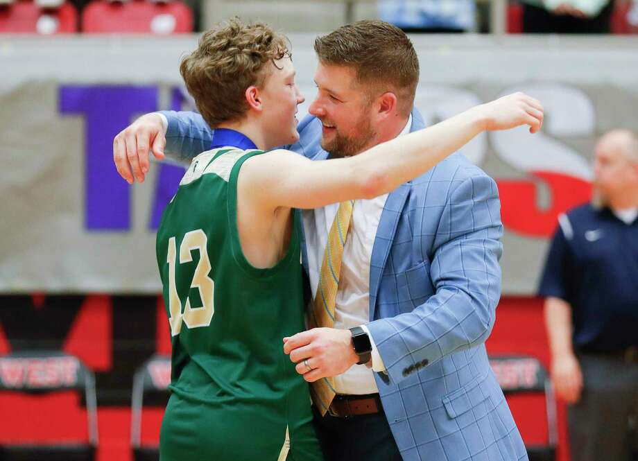 The Woodlands Christian Academy head coach Tanner Field embraces Austin Benigni (13) after the Warriors won their second title in three years last year. Benigni is expected to play more of a leadership role as he enters his junior season. Photo: Jason Fochtman, Houston Chronicle / Staff Photographer / Houston Chronicle  © 2020