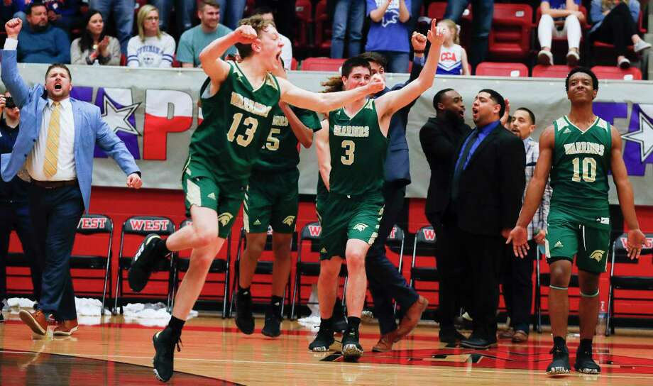 In this file photo, The Woodlands Christian Academy point guard Austin Benigni (13) reacts with teammates after the Warriors won their second title in three years with a 68-50 victory over Colleyville Covenant Christian during the TAPPS Class 4A high school basketball championship at West High School, Saturday, Feb. 29, 2020, in West. Photo: Jason Fochtman, Houston Chronicle / Staff Photographer / Houston Chronicle  © 2020