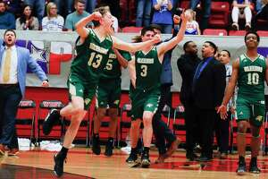 In this file photo, The Woodlands Christian Academy point guard Austin Benigni (13) reacts with teammates after the Warriors won their second title in three years with a 68-50 victory over Colleyville Covenant Christian during the TAPPS Class 4A high school basketball championship at West High School, Saturday, Feb. 29, 2020, in West.