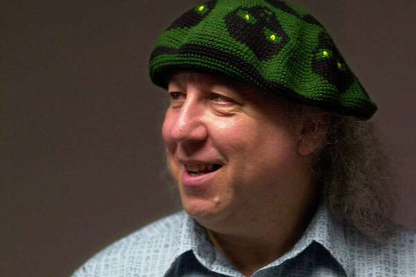 In this file photo dated Saturday, April 7, 2001, British rock and blues guitarist Peter Green, a founding member of Fleetwood Mac, backstage before performing with his own band, Peter Green's Splinter Group, at B.B. King Blues Club & Grill, in New York. Lawyers representing the family of Peter Green, say in a statement Saturday July 25, 2020, that he has died, aged 73.