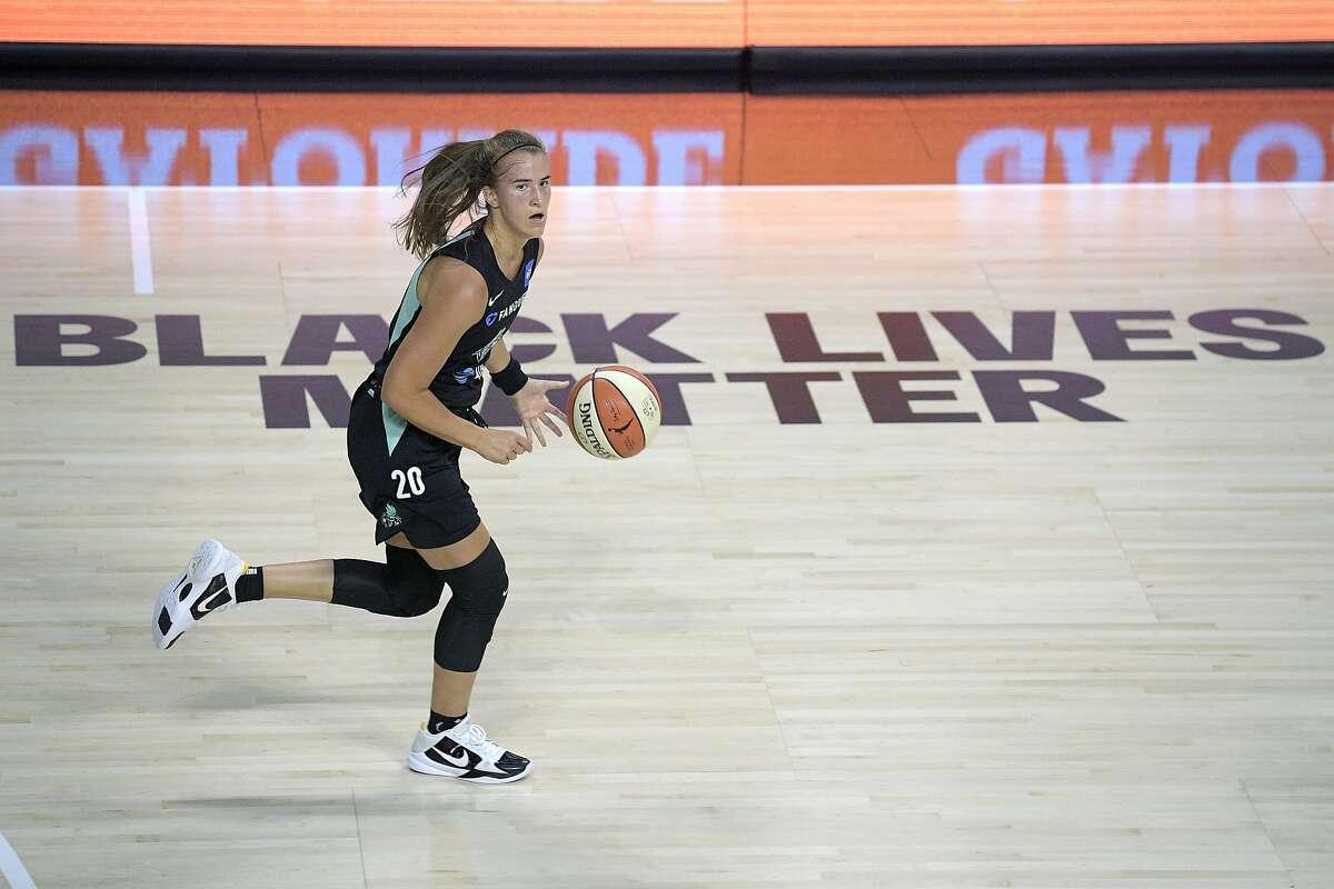 New York Liberty forward Sabrina Ionescu pushes the ball up the court during the first half of the WNBA season opener, the Miramonte-Orinda alum's WNBA debut, Saturday in Bradenton, Fla.