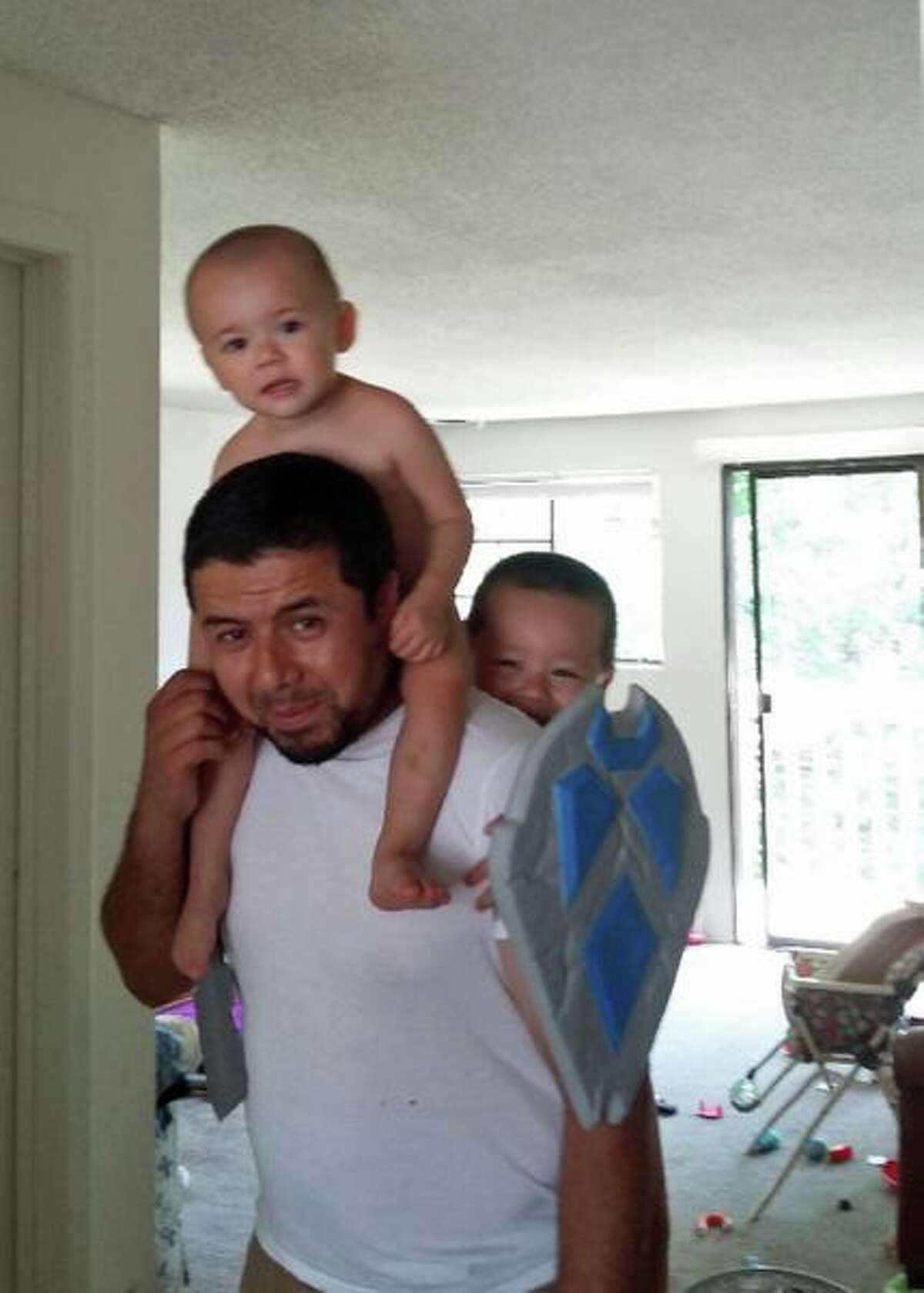 Bakhodir Madjitov smiles with two of his sons in 2016. Madjitov, a Connecticut resident, has been detained by U.S. Immigration and Customs Enforcement in 2017.