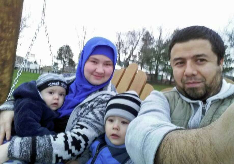 Bakhodir Madjitov (right) is seen here with his wife Madina Mamadjonova and two of their sons in 2015. Madjitov was detained by U.S. Immigration and Customs Enforcement in 2017 and remains in detention. Photo: Contributed