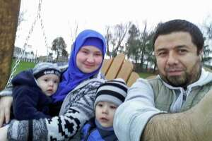 Bakhodir Madjitov (right) is seen here with his wife Madina Mamadjonova and two of their sons in 2015. Madjitov was detained by U.S. Immigration and Customs Enforcement in 2017 and remains in detention.