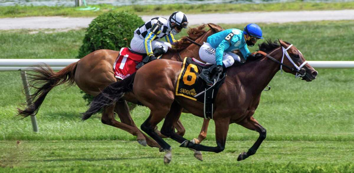 #6 Starship Jubilee ridden by Javier Castellano passes #1 Call Me Love ridden by Joel Rosario to win the 32nd running of The Ballston Spa Saturday July 25, 2020 at the Saratoga Race Course in Saratoga Springs, N.Y. Photo by Skip Dickstein/Special to the Times Union.