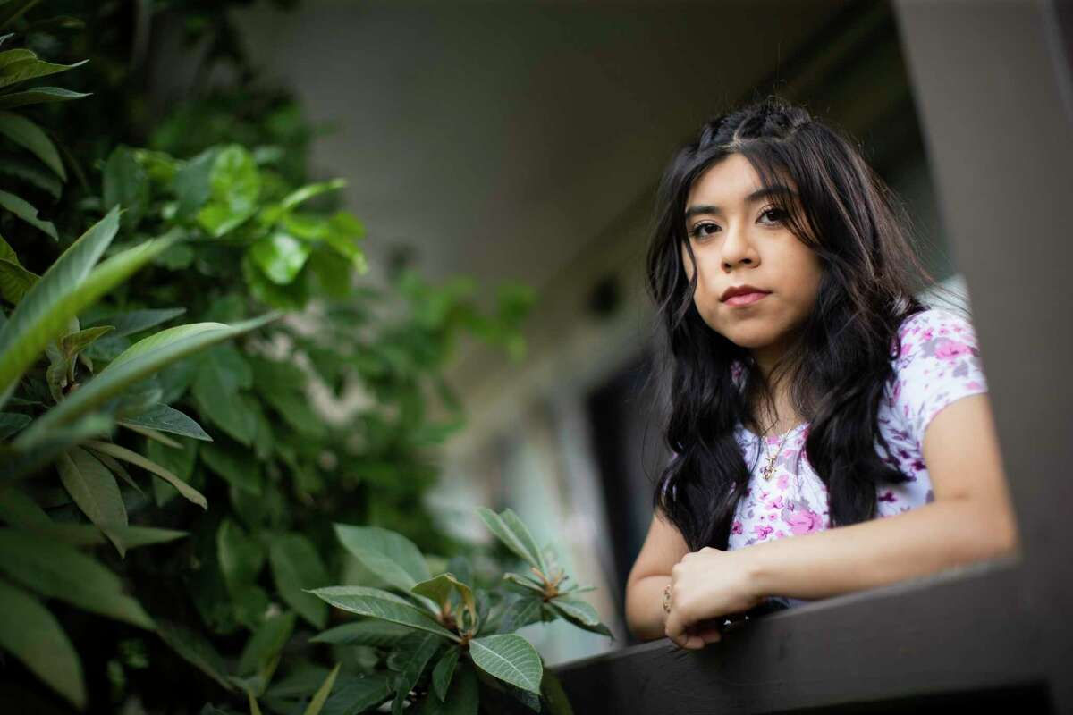 Anahi Lagunas Ausencio, 19, outside her home in Houston Friday, July 24, 2020. Lagunas Ausencio is one of dozens of plaintiffs on a new lawsuit trying to force the Trump administration to accept new DACA applications. She's studying nursing at Lone Star College, but can't become a nurse without a work permit from DACA.