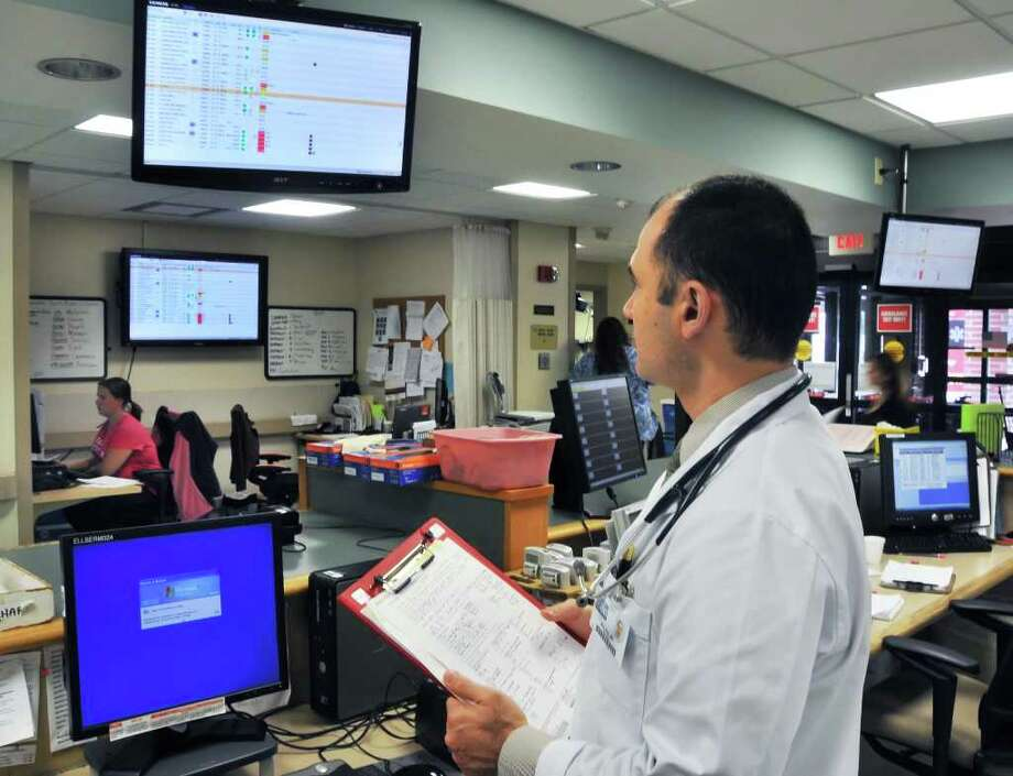 Dr. Avi Alin checks one of the monitors of the new ER patient board at Ellis Hospital.   (John Carl D'Annibale / Times Union) Photo: John Carl D'Annibale / 00009975A