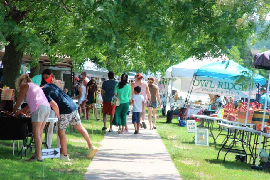 The Frankfort Farmers Market, a few blocks down from the Street Sale, also had plenty of visitors on Saturday. (Photo/Colin Merry)