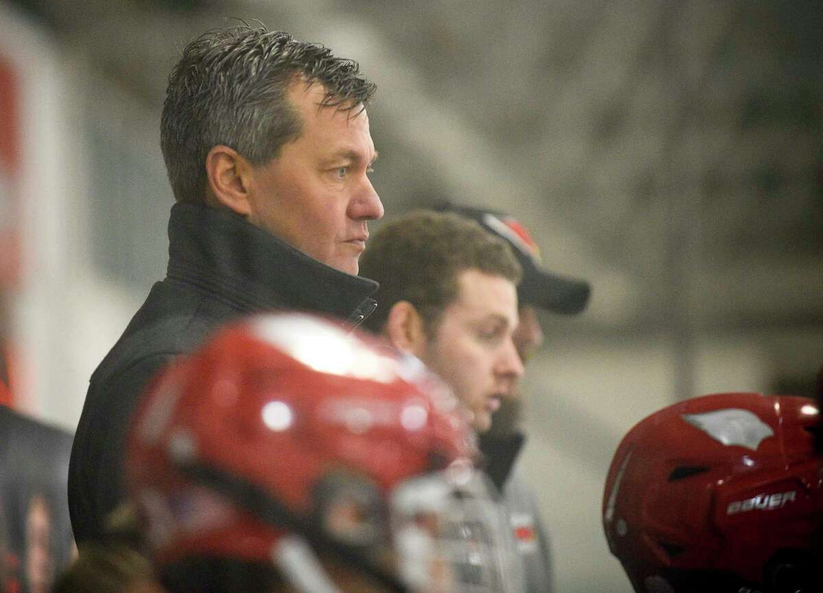 Greenwich coach Chris Rurak watches as the Cardinals take on Ridgefield in an FCIAC boys hockey game at Hamill Rink in Greenwich in February.