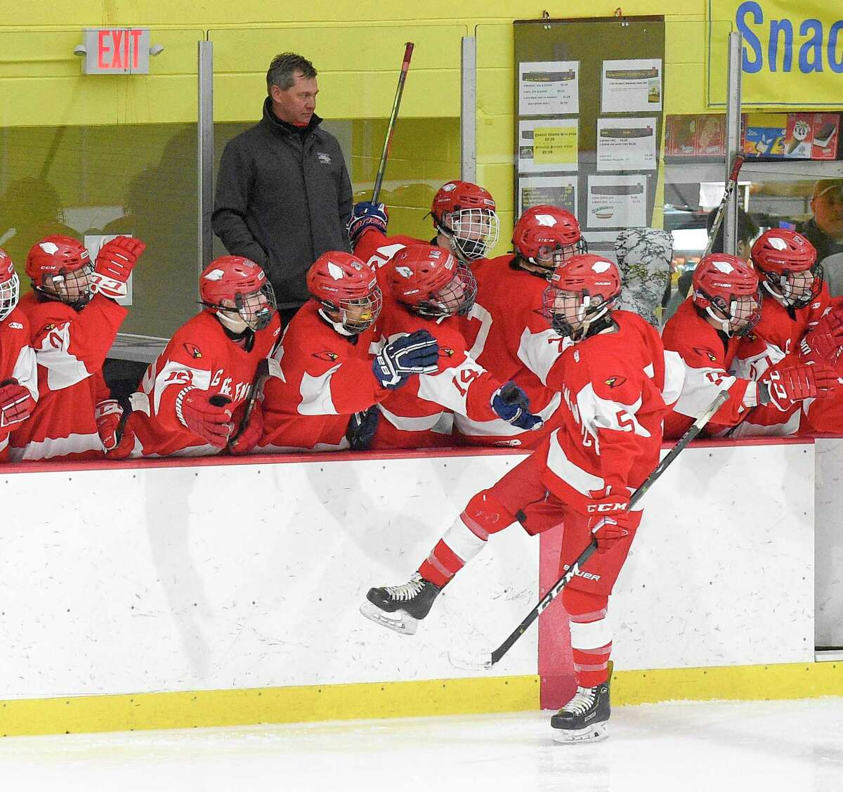 Greenwich coach Chris Rurak watches as players react to a goal against the Stamford-Westhill Co-op in a FCIAC boys hockey game at Terry Connors Ice Rink in January.