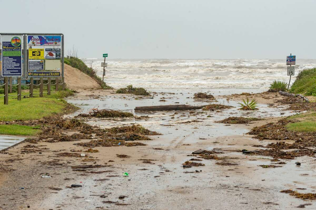 The Stingaree Drive entry to the beach in Crystal River, Texas is blocked by debris brought up by the high tide caused by Hurricane Hanna on Saturday morning. Even though Hurricane Hanna made landfall several hundred miles south of the Bolivar Peninsula, the storm still had an effect on the area. Photo made on July 25, 2020. Fran Ruchalski/The Enterprise